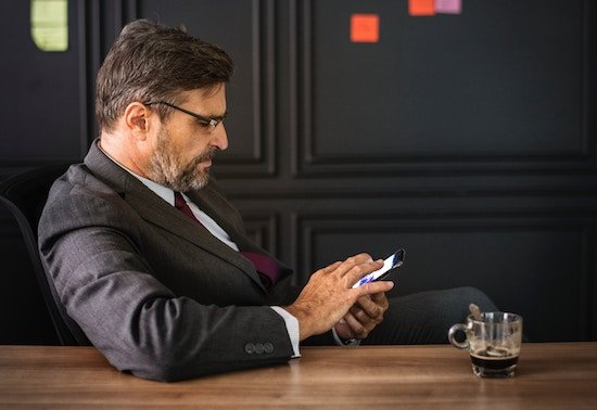 A business owner monitoring his video security system from his phone