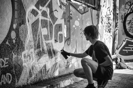 A criminal applying graffiti to a local Okanagan business