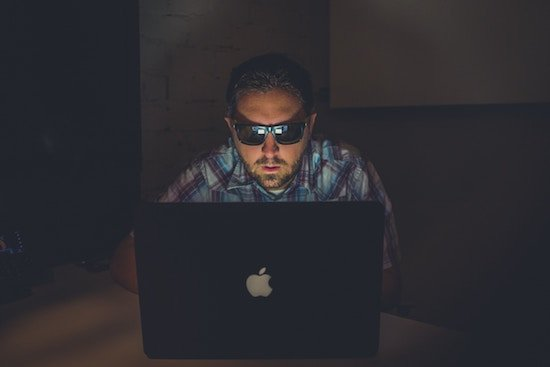 A hacker attempting to gain access to a business security system